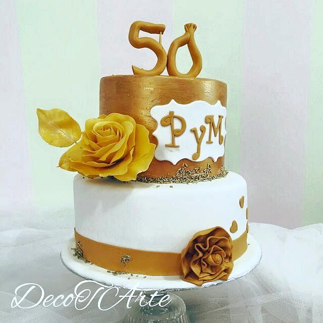 Gold and white wedding cake for Golden wedding anniversary