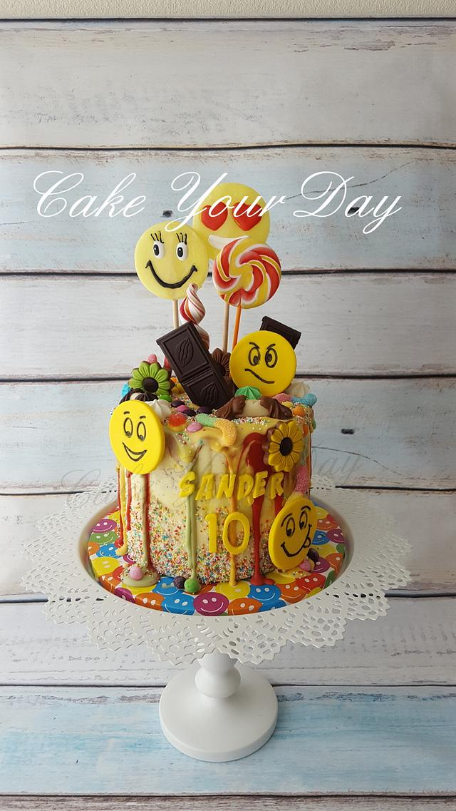 Emoji Cake with lots of sweets.