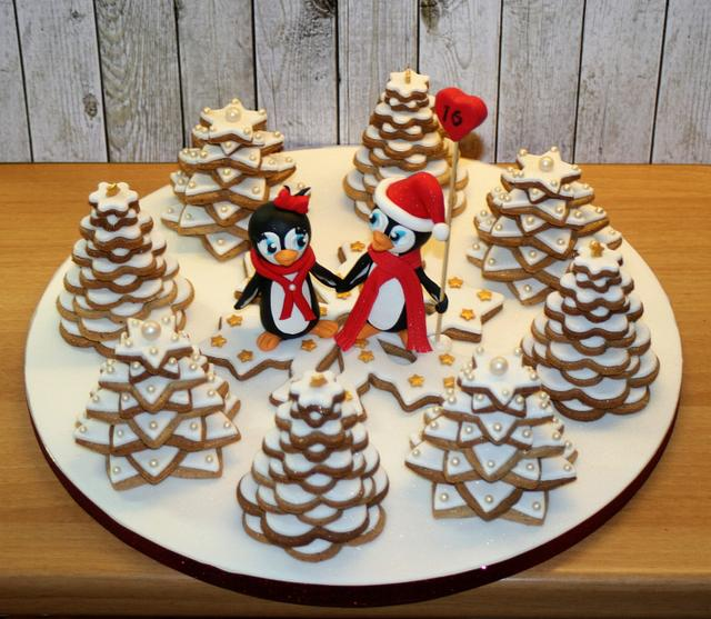 Penguins in love in a xmas tree cookie forest