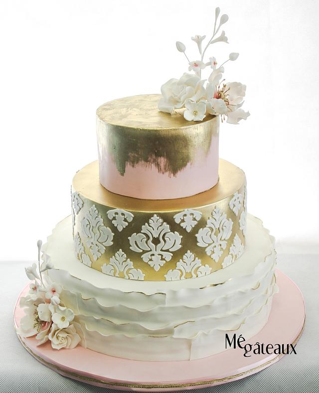 gold and soft pink wedding cake