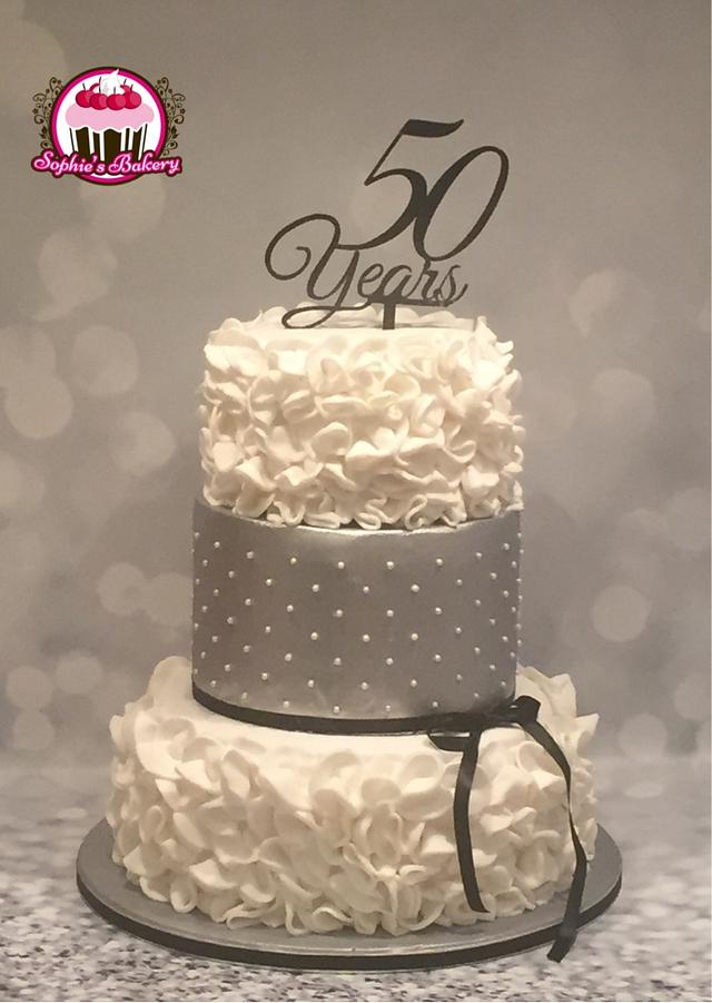 White and silver 50th birthday cake