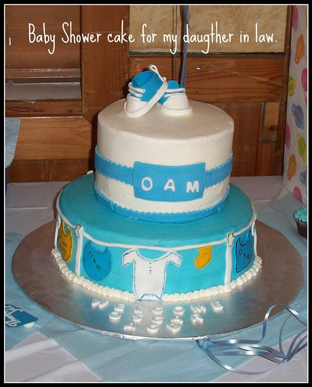 Baby Shower Cake with Baby Initals, Clothesline and gumpaste booties.