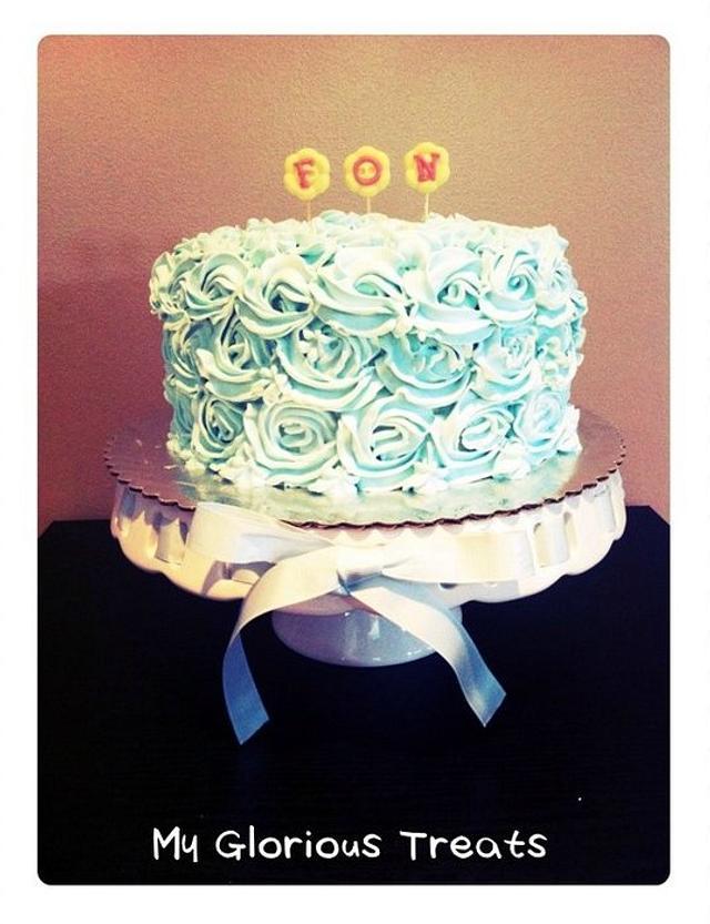 Light blue swirl rose ice cream cake