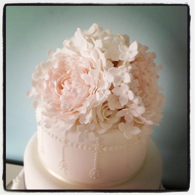 Blush peony and pearl wedding cake