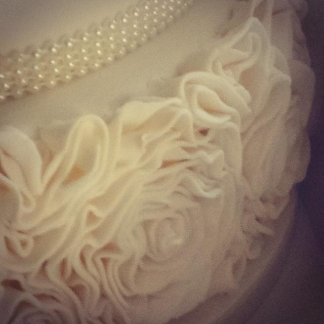 Ruffle and jewel wedding cake