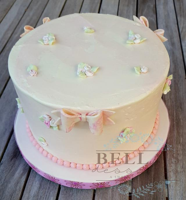 Blossoms and bows baby shower cake