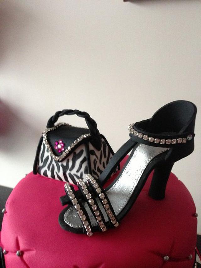 zebra ,pink ,shoes handbag and bling cake