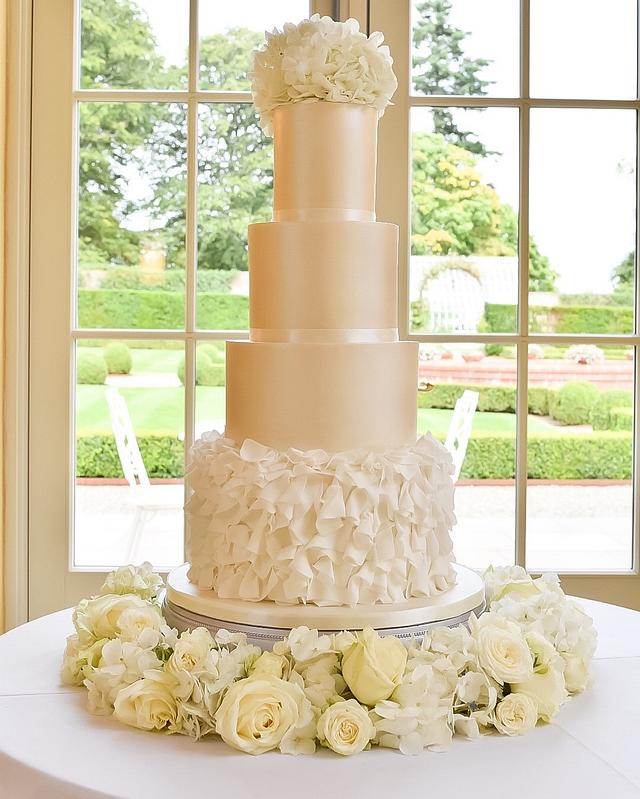 Ruffles and shimmer wedding cake