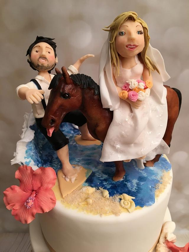 wedding cake with surfer and horse!