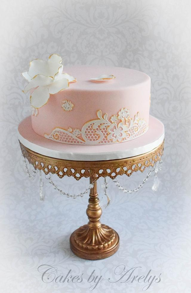 Gilded lace and flower cake