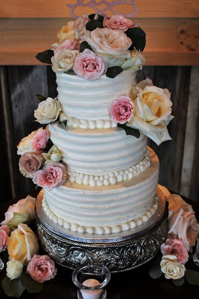 Buttercream wedding cake fresh flowers