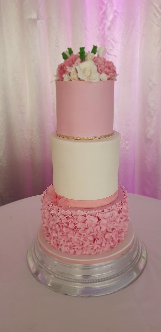 Pink and white wedding cake.