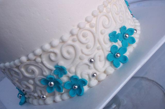 teal blossoms with scrolls