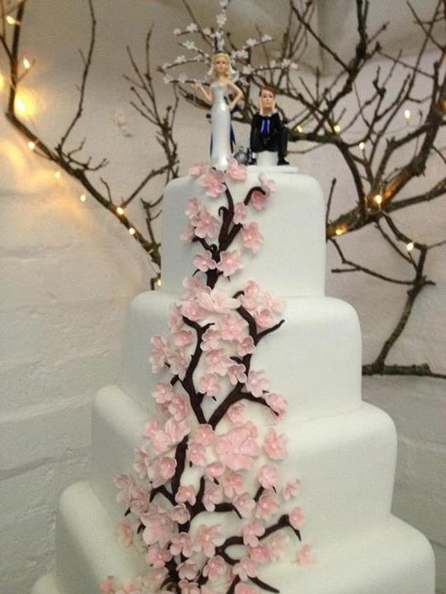 Cherry  blossom pettals with cherry tree on top, five tier, square fruit