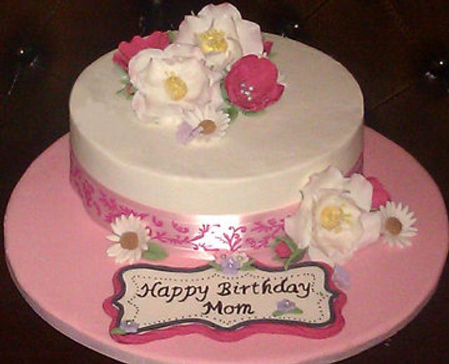 Simple butter cream cake with fondant flowers