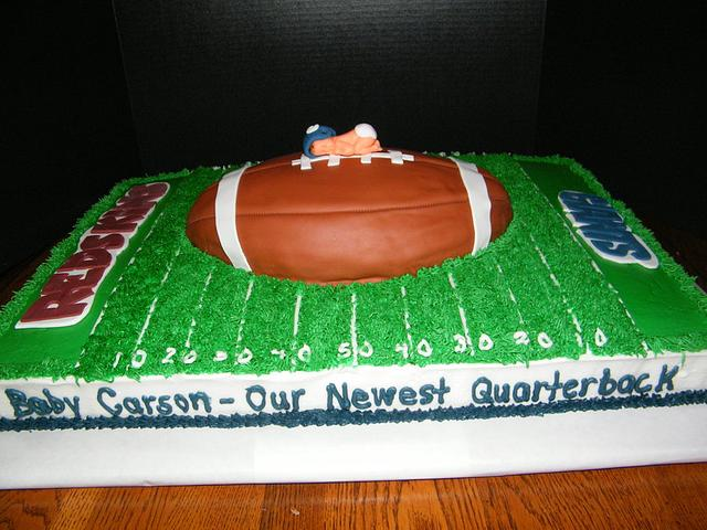 Football themed baby shower cake