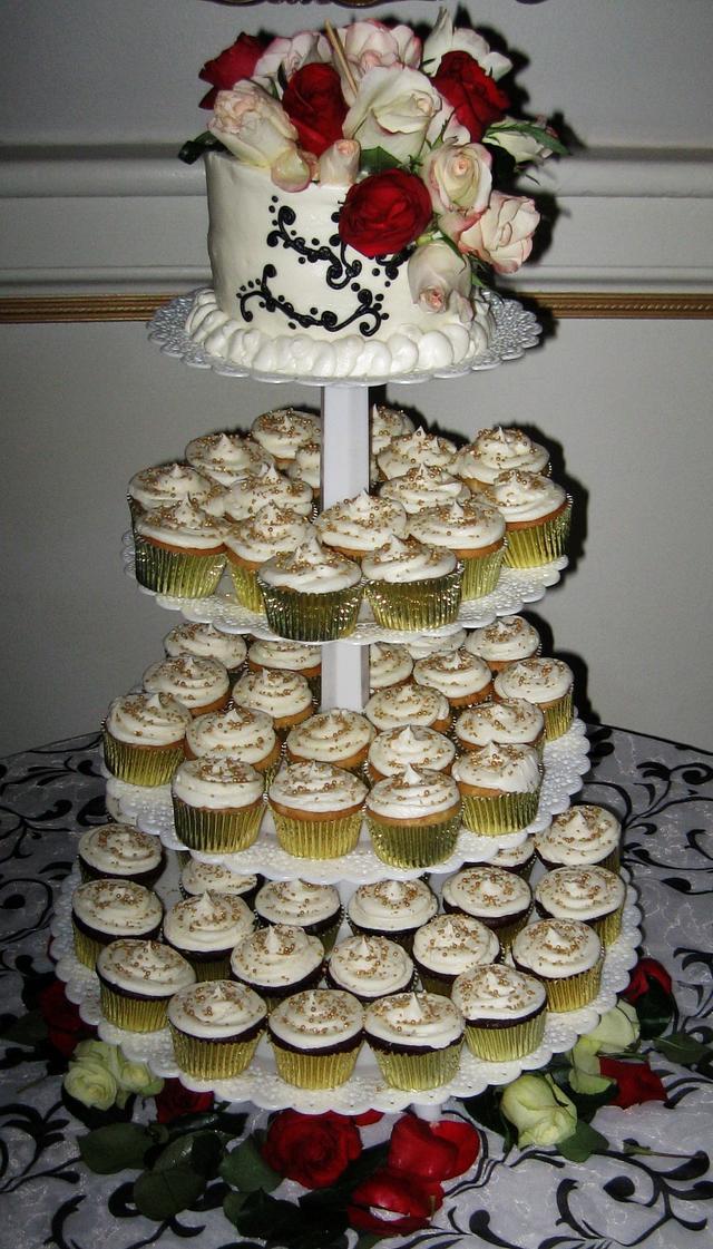Wedding cupcakes, & top tier cake. Gold, black & burgundy.