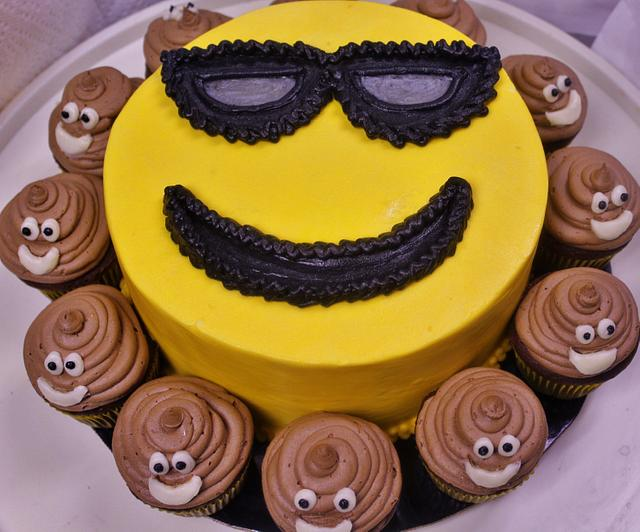 Smiley face cake with poo cupcakes (LOL)