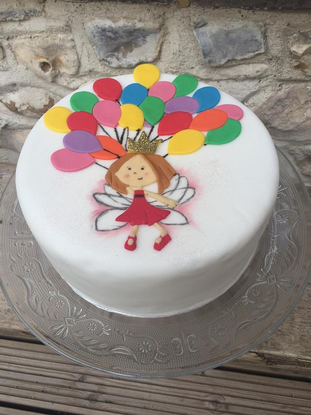 Fairy holding balloons cake