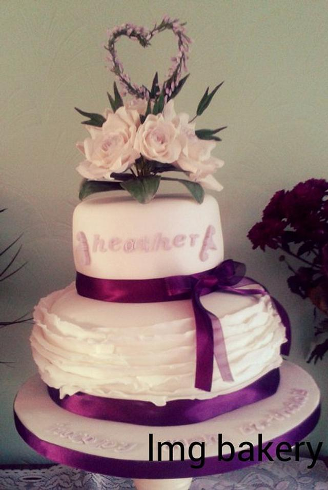 handmade heather 80th birthday cake with frills and roses