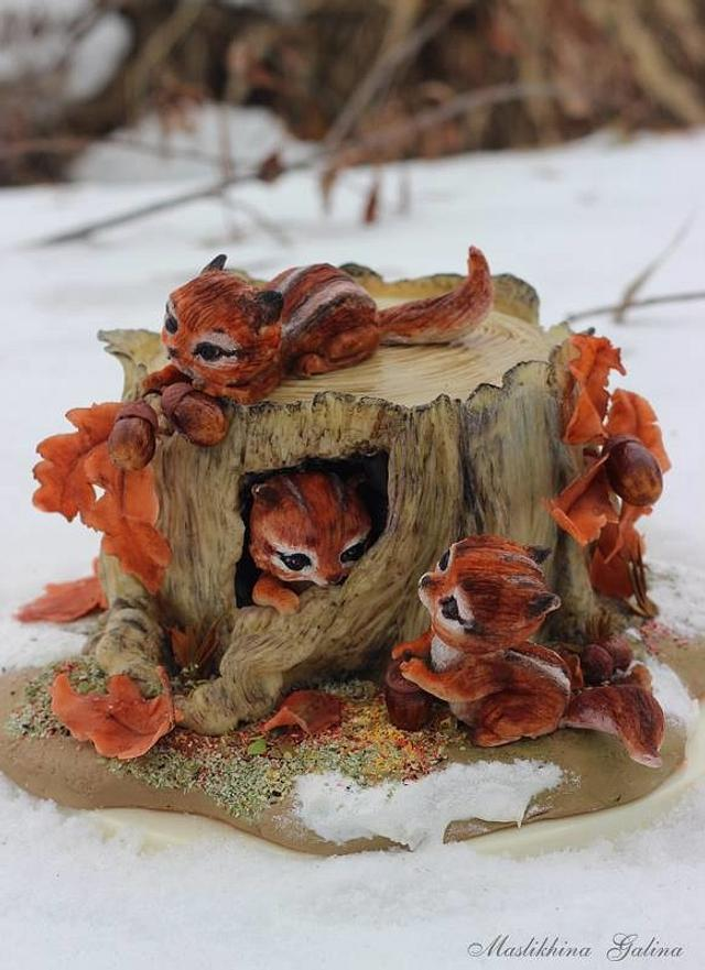 Chipmunks on an old stump