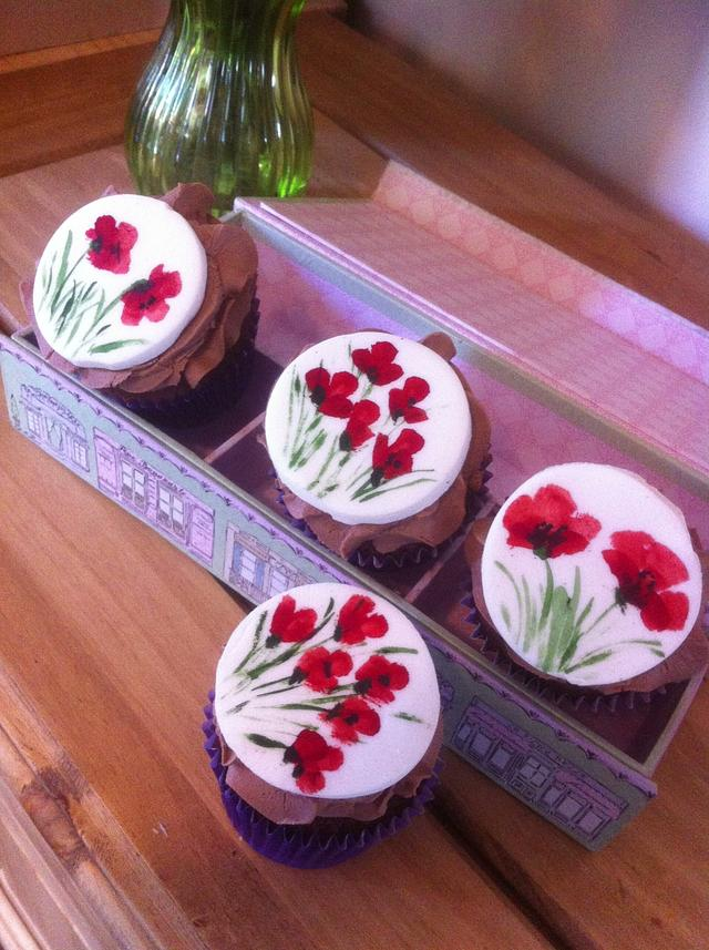 Hand painted poppy cupcakes