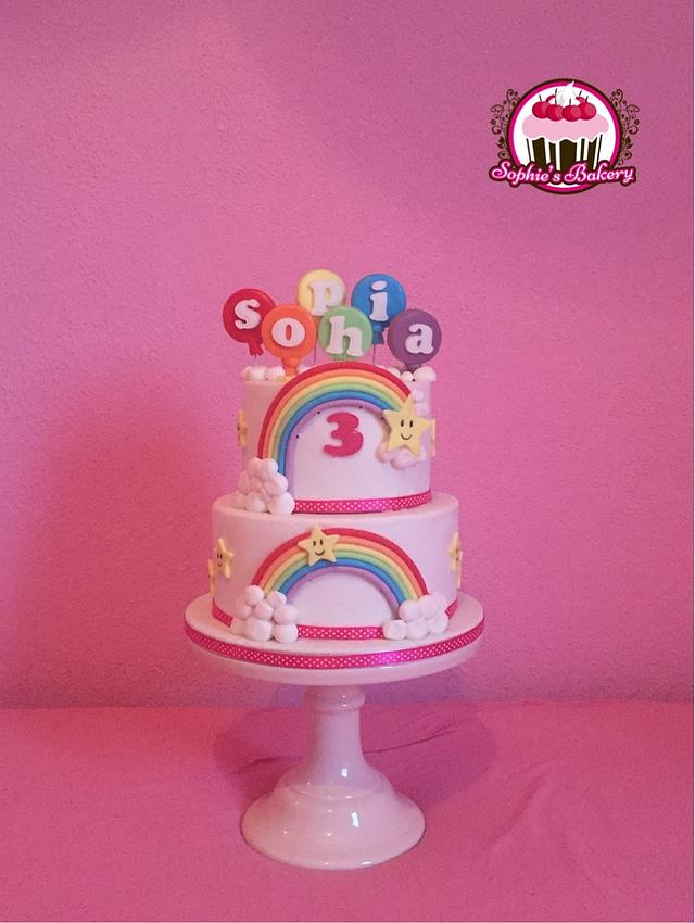 Rainbow stars clouds and balloons cake
