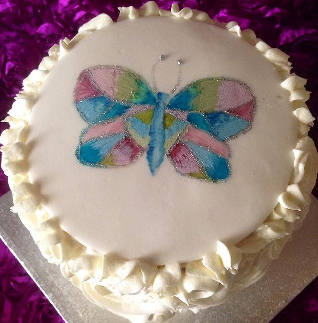 Hand painted butterfly rainbow birthday cake