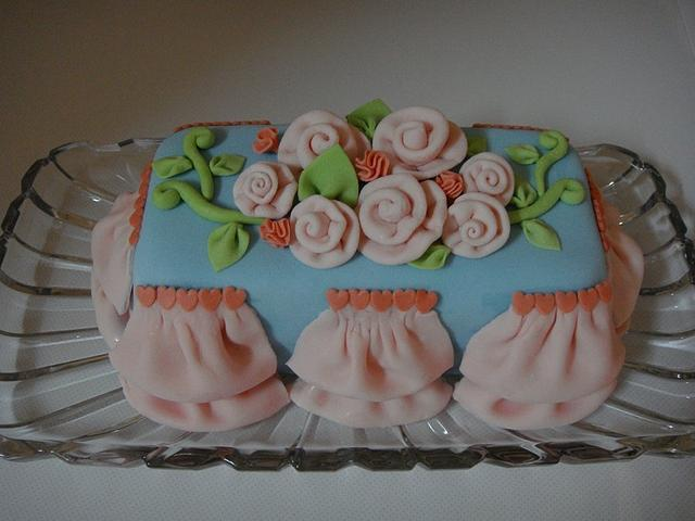 white cake with pink heart inside.