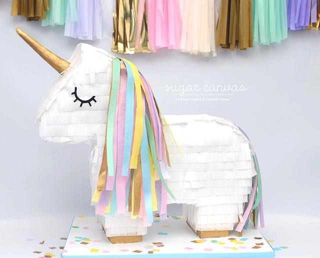 Unicorn piñata cake!