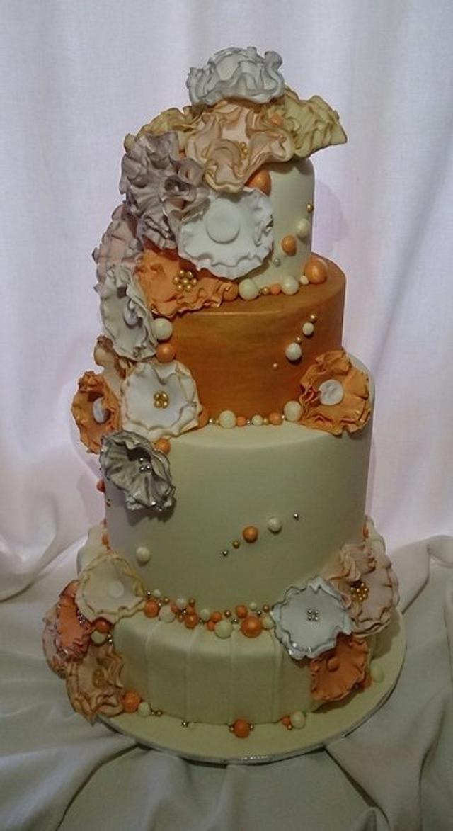 cream gold and peach tiered wedding cake