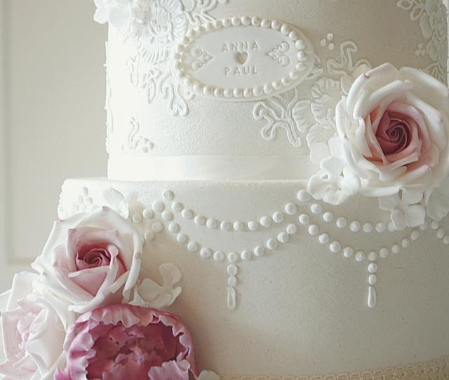 Wedding cake with roses and peonies