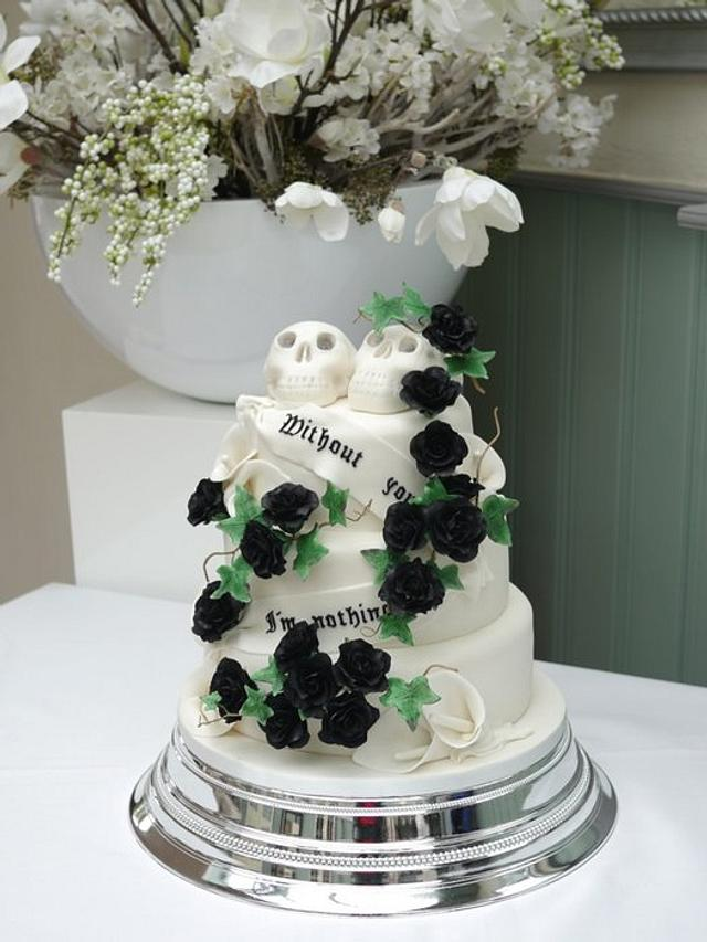 Black roses, white calla's and skulls wedding cake.