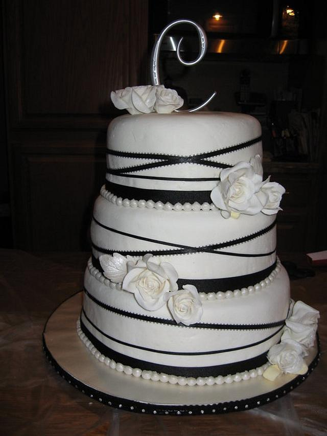 Ivory and black ribbon cake with gumpaste roses
