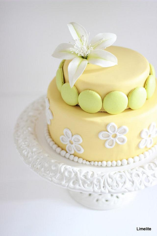 Limelite! A Two tier cake adorned with beautiful macarons and flower paste bombax flower