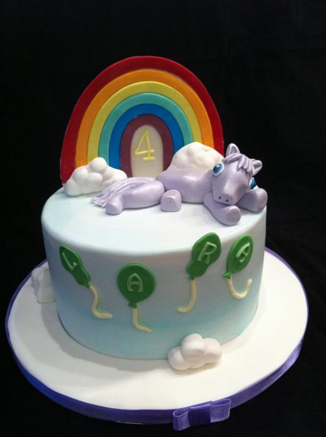 pony and rainbow in the clouds
