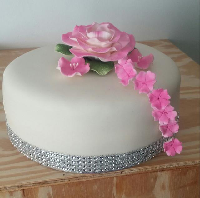 Sweet cake with pink flowers