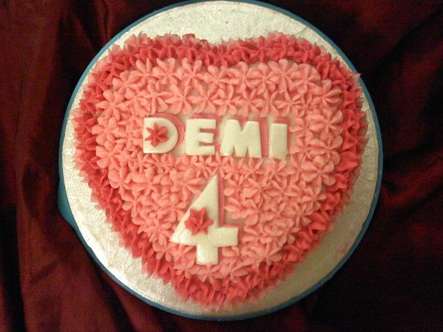 Pink heart birthday cake