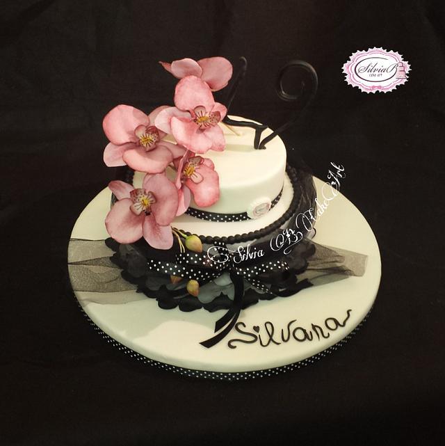 Black and white cake whit an elegant phalaenopsis orchid