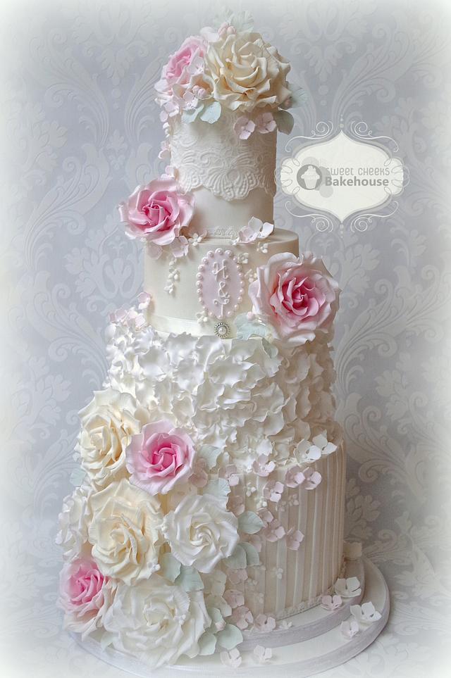 cream and white rose stripe cake