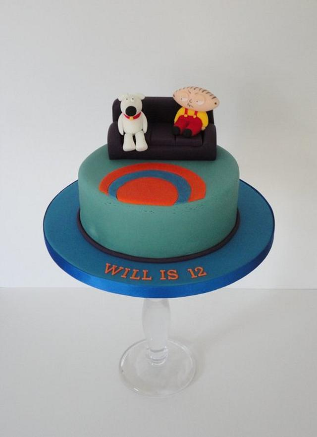 Family guy style cake, stewie and brian on the sofa