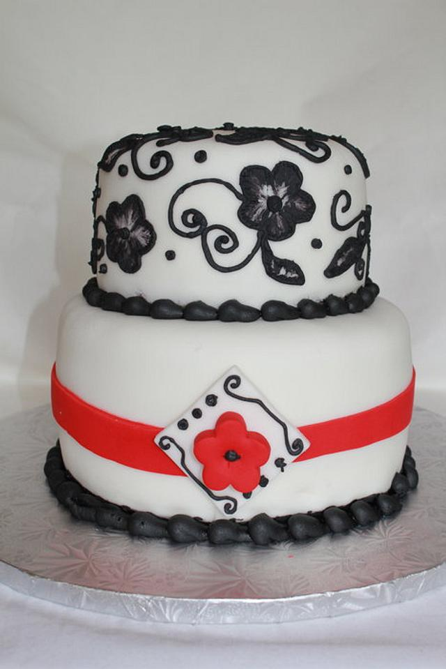 black embossed flowers with red ribbon