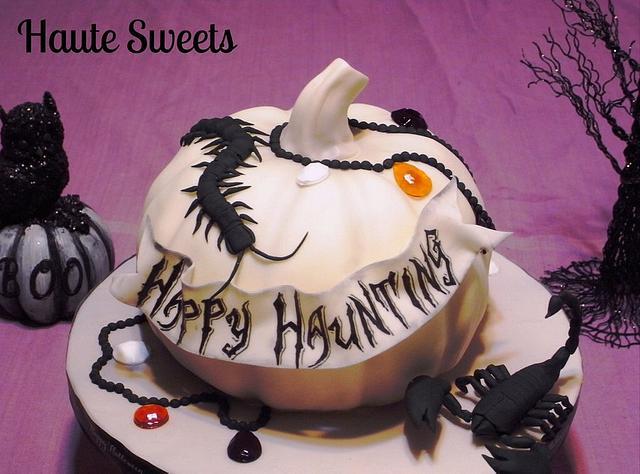 White pumpkin and creepy crawlers Halloween cake