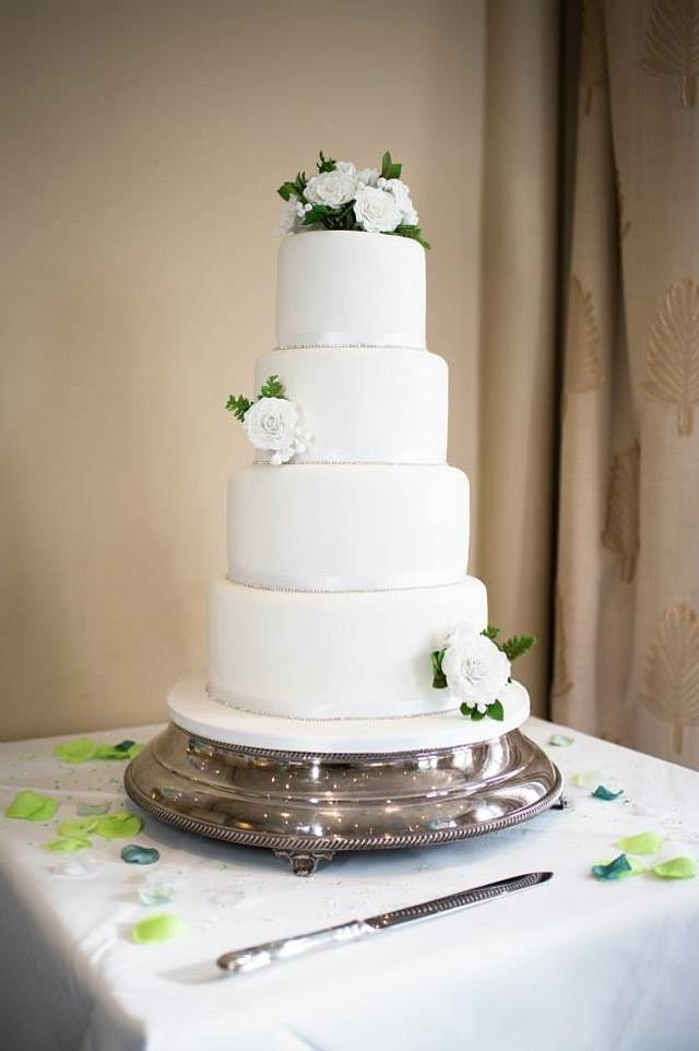 Rose, freesia and fern classic wedding cake