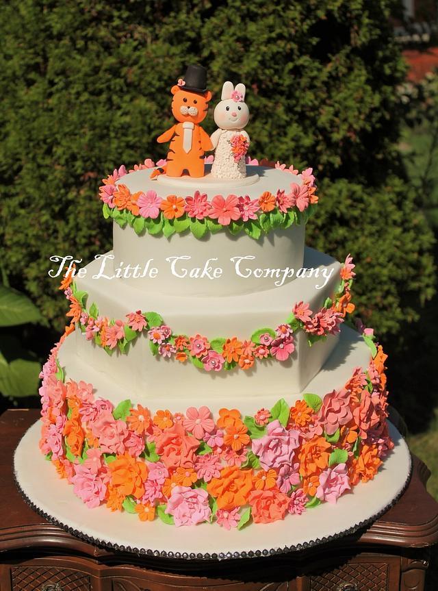 pink, coral and orange wedding cake