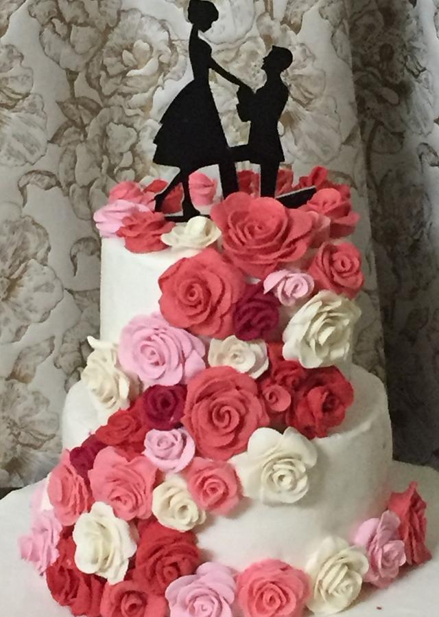 Wedding cake with rose cascade