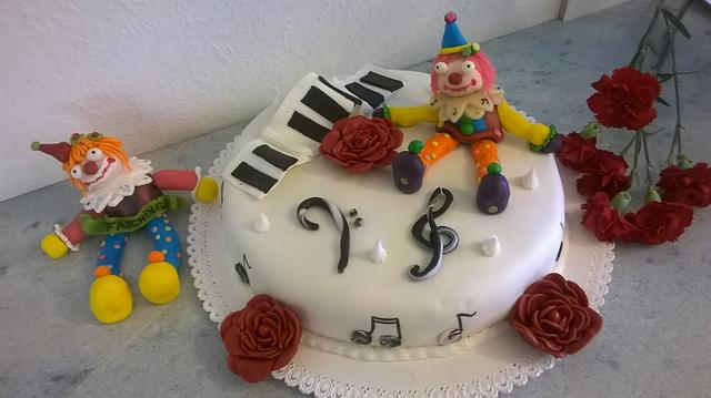 Carnival birthday cake  for a piano player