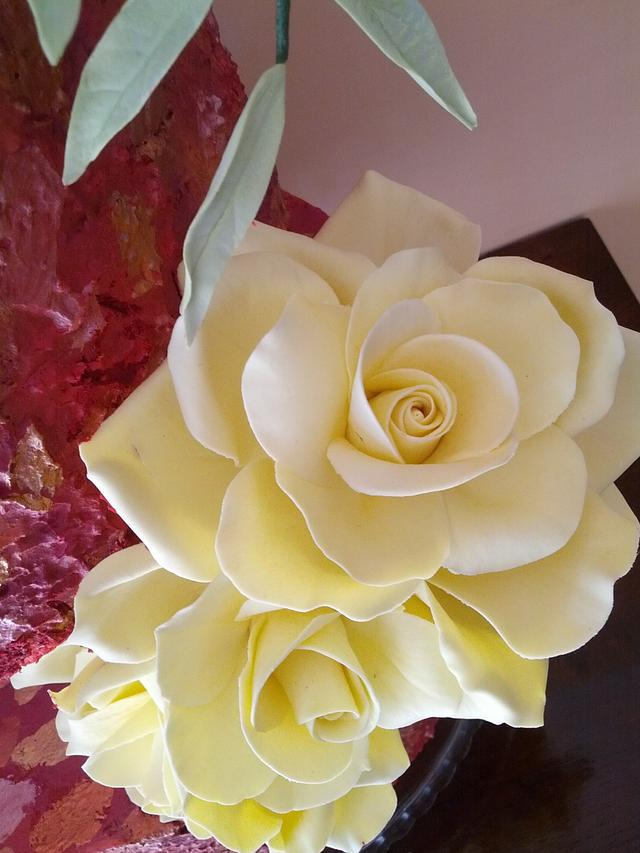 painted cake and yellow roses