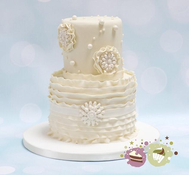 Two tier ruffles, pearls and 'bling' wedding cake
