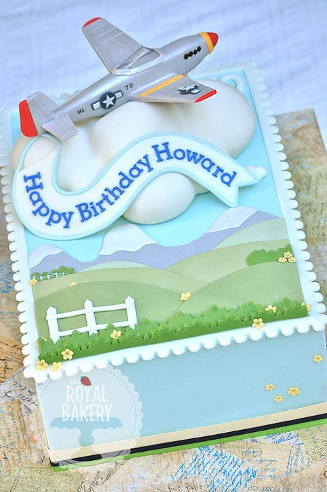 Airplane on a cloud on a stamp on a cake